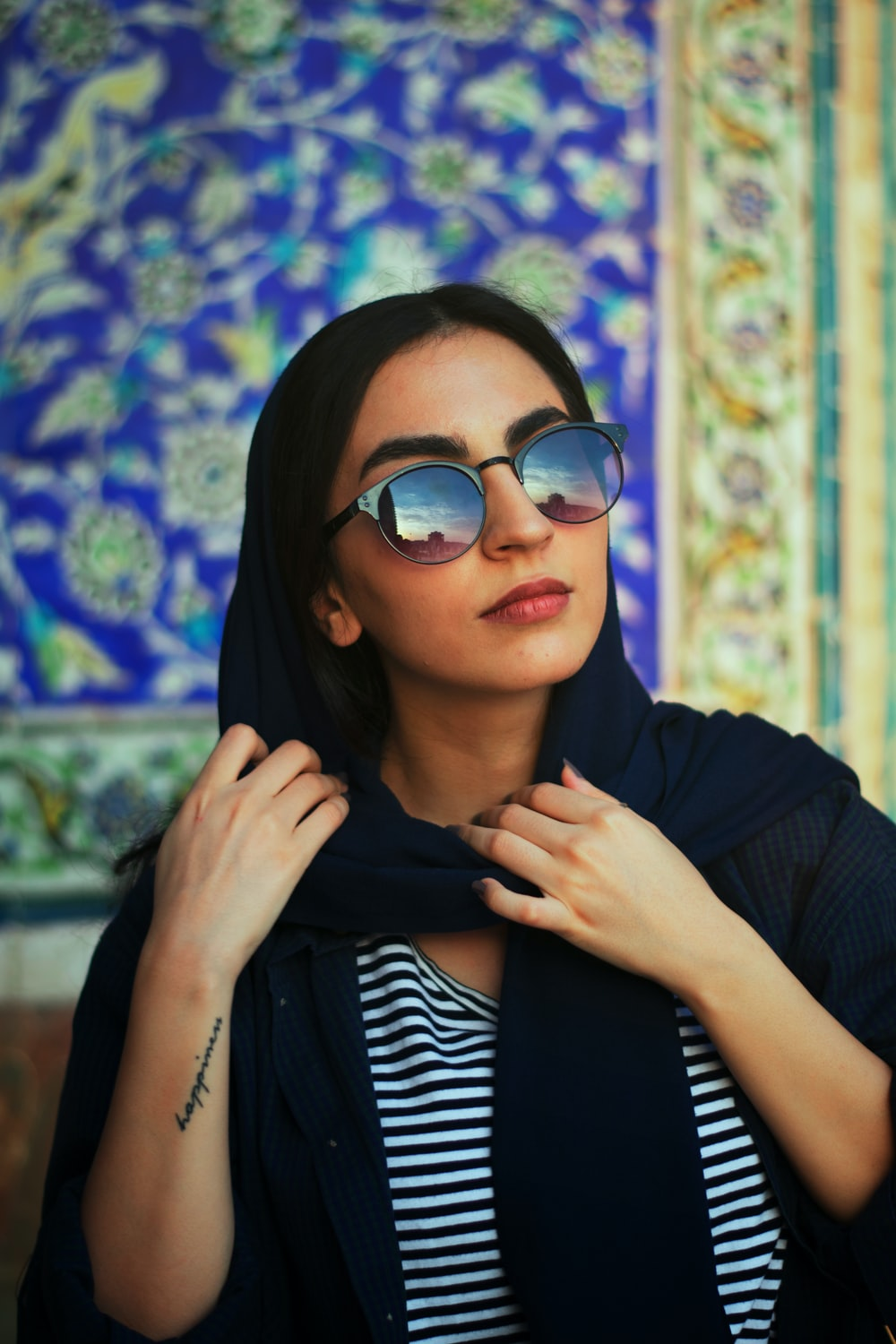 woman in black and white striped long sleeve shirt wearing black framed sunglasses
