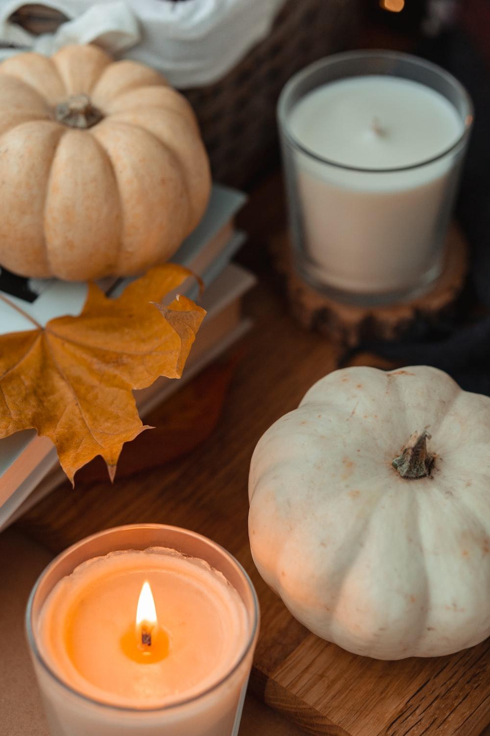 white pumpkin beside white ceramic mug on brown wooden table