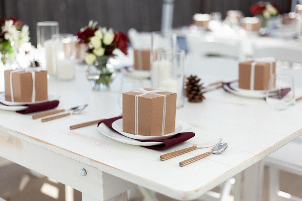 brown and white ceramic mug on white ceramic plate