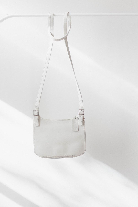 white leather handbag on white surface