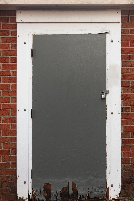 black wooden door with white steel door knob