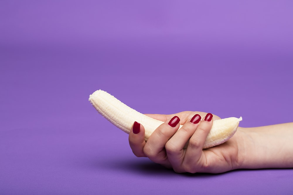 person holding sliced of bread