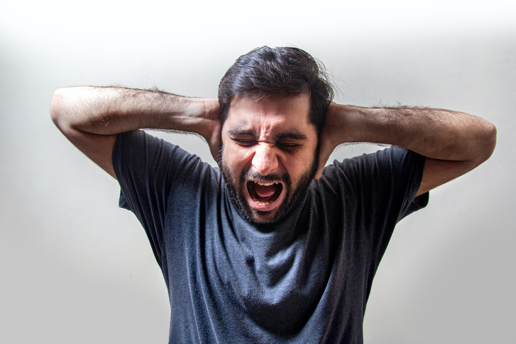 Frustrated Young Man Screaming in Fear