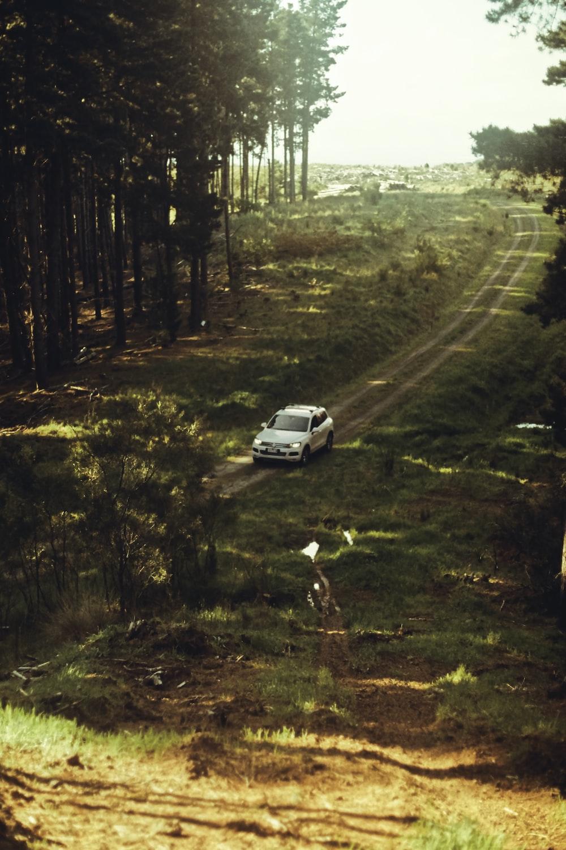 white car on dirt road