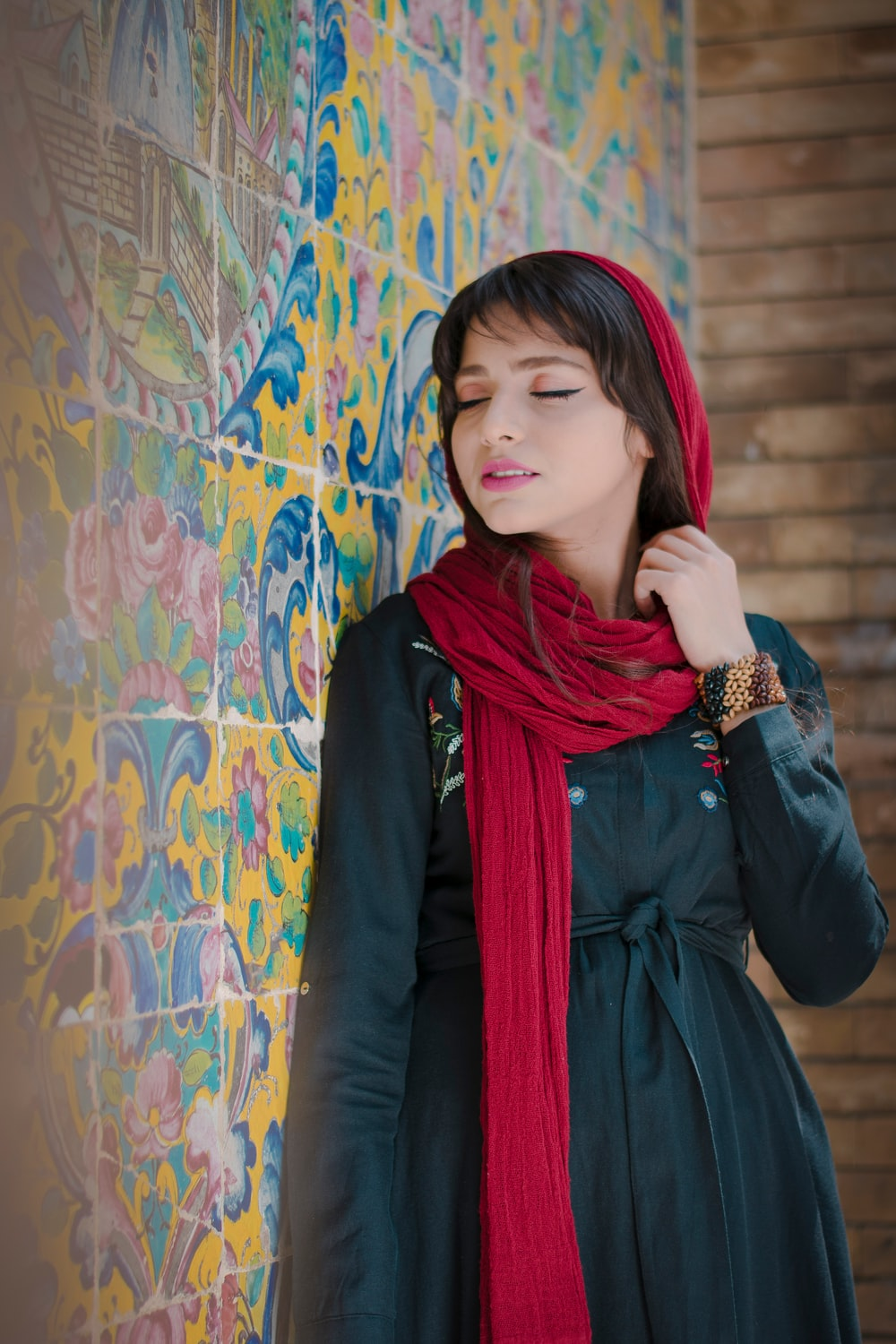 woman in black long sleeve shirt and red scarf