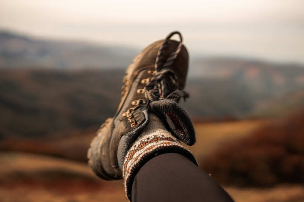 person wearing brown hiking shoes