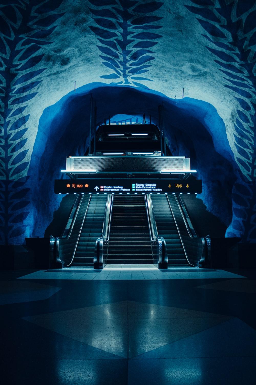 black and gray escalator in a tunnel