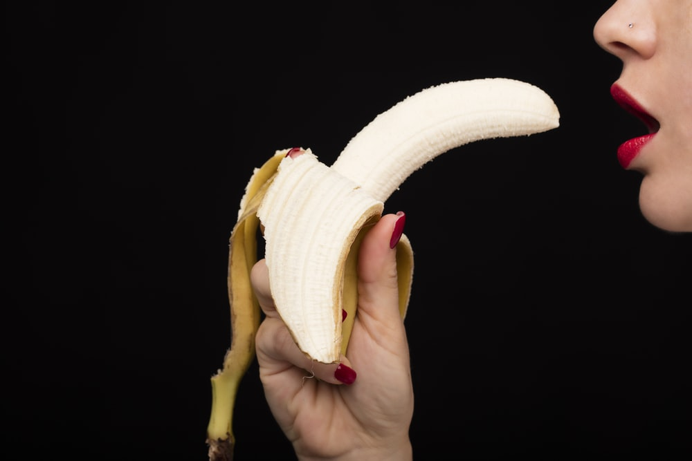 person holding yellow banana fruit