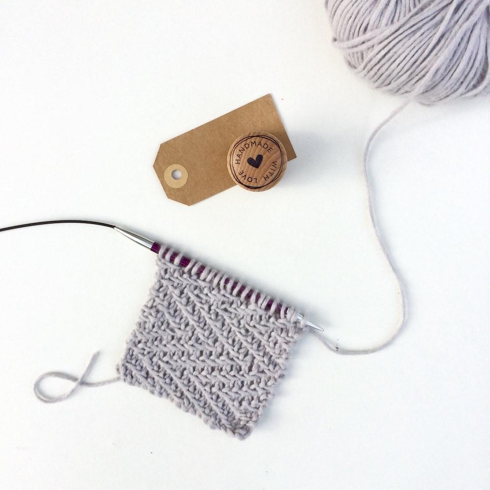 white earbuds on white textile