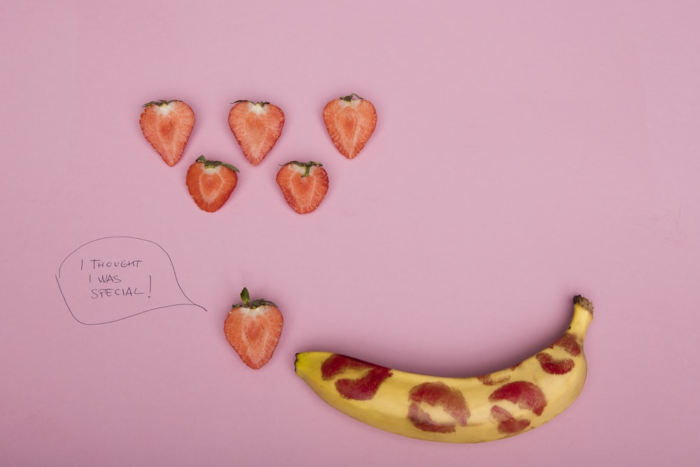 yellow banana fruit and brown oval fruits