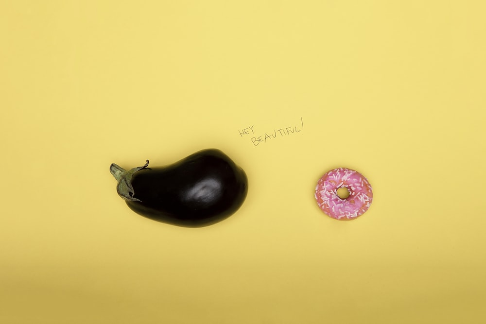 pink doughnut on yellow surface