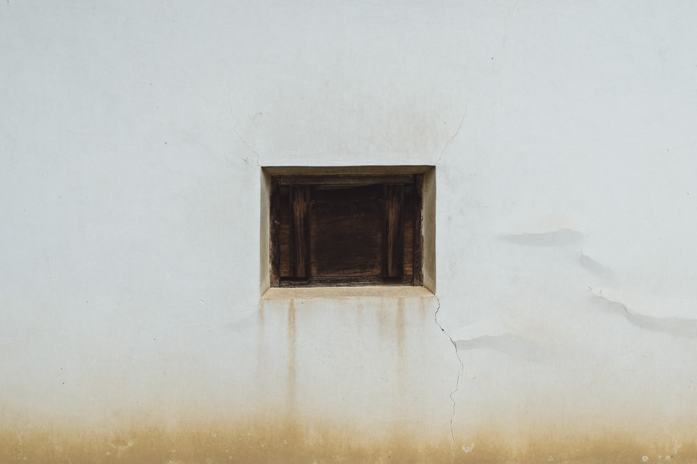 brown wooden window on white wall
