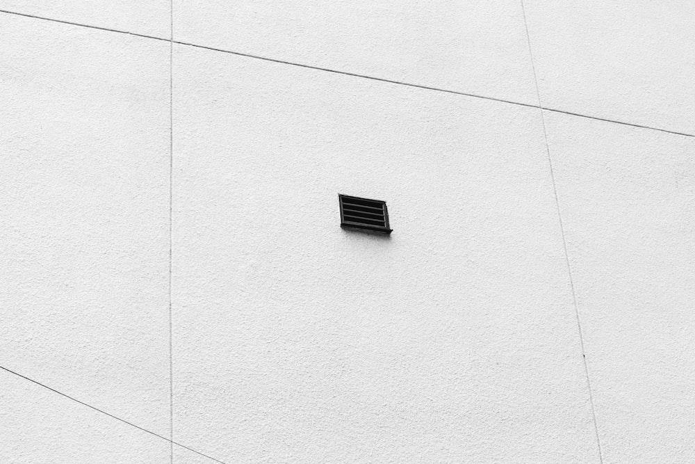 black window on white concrete wall