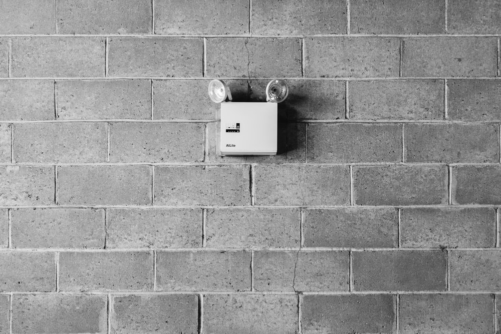 white and black wall mounted device