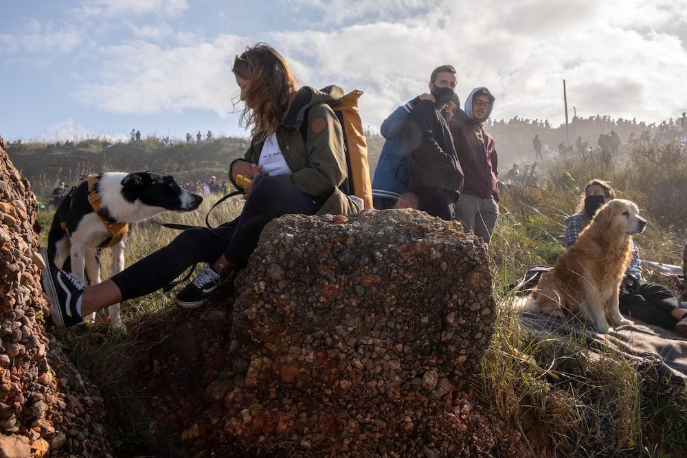 people sitting on rock during daytime
