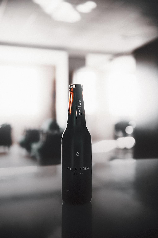 black glass bottle on table