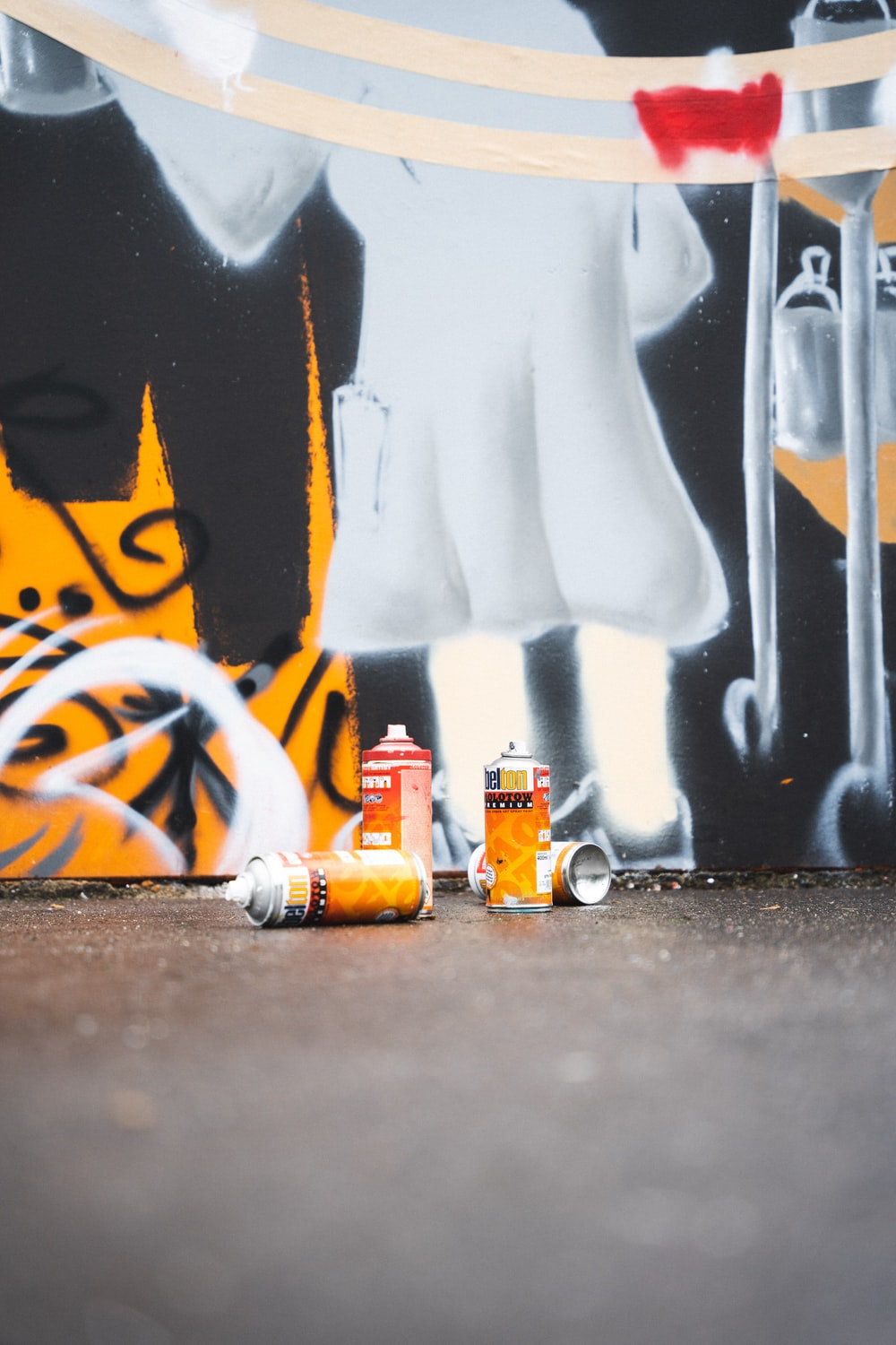 white and orange can on black table