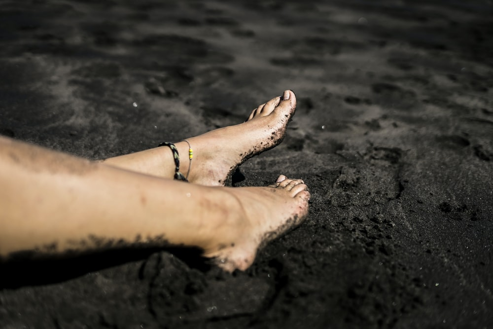 persons feet on beach