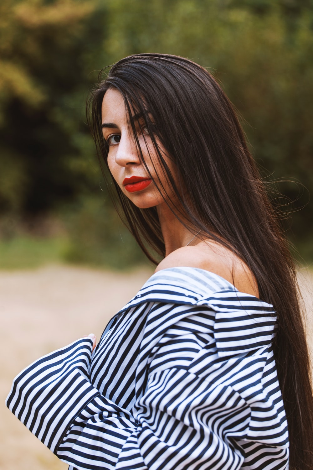 woman in white and black striped off shoulder shirt