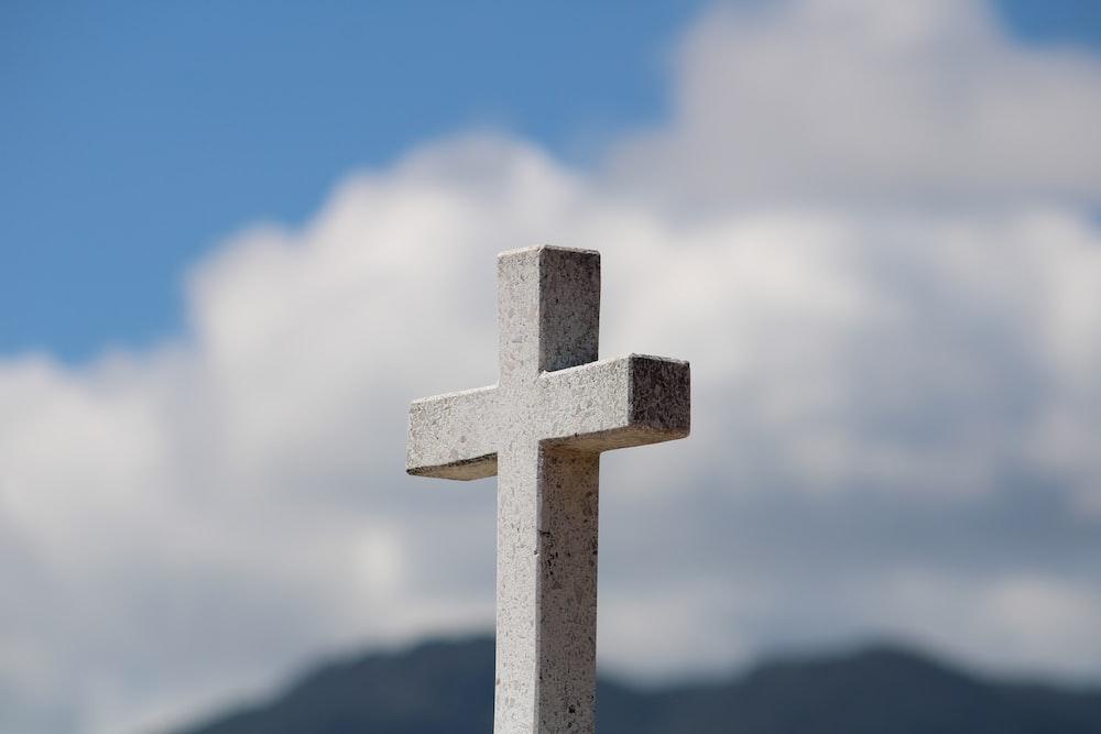 white cross under blue sky during daytime