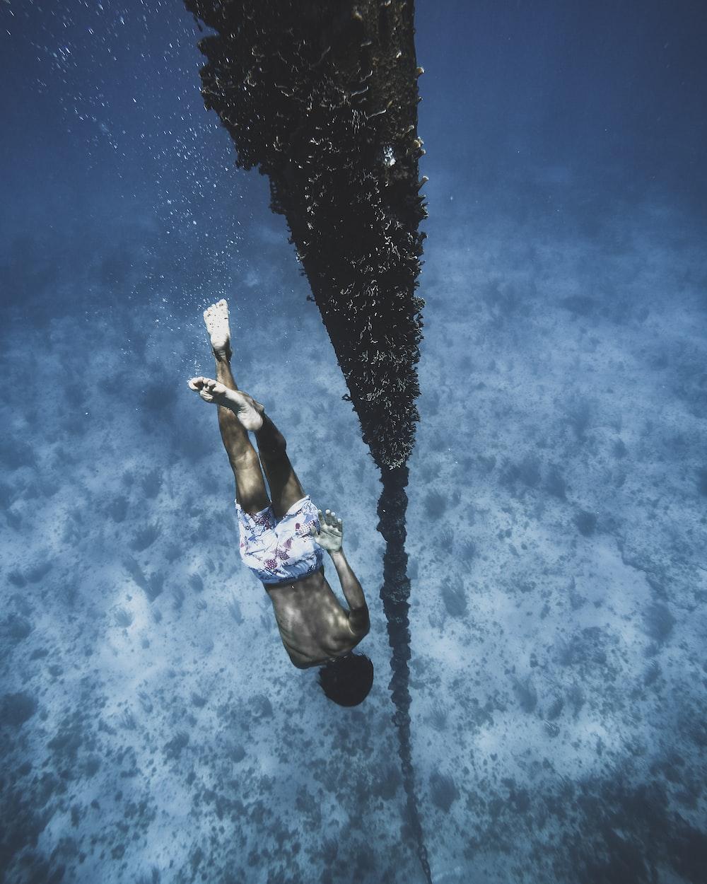 woman in blue and white bikini swimming in water