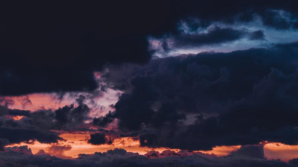 black clouds and orange sky