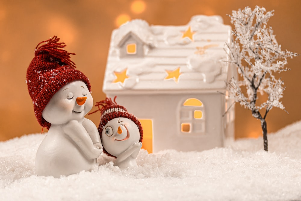 snowman with red hat and white fur coat