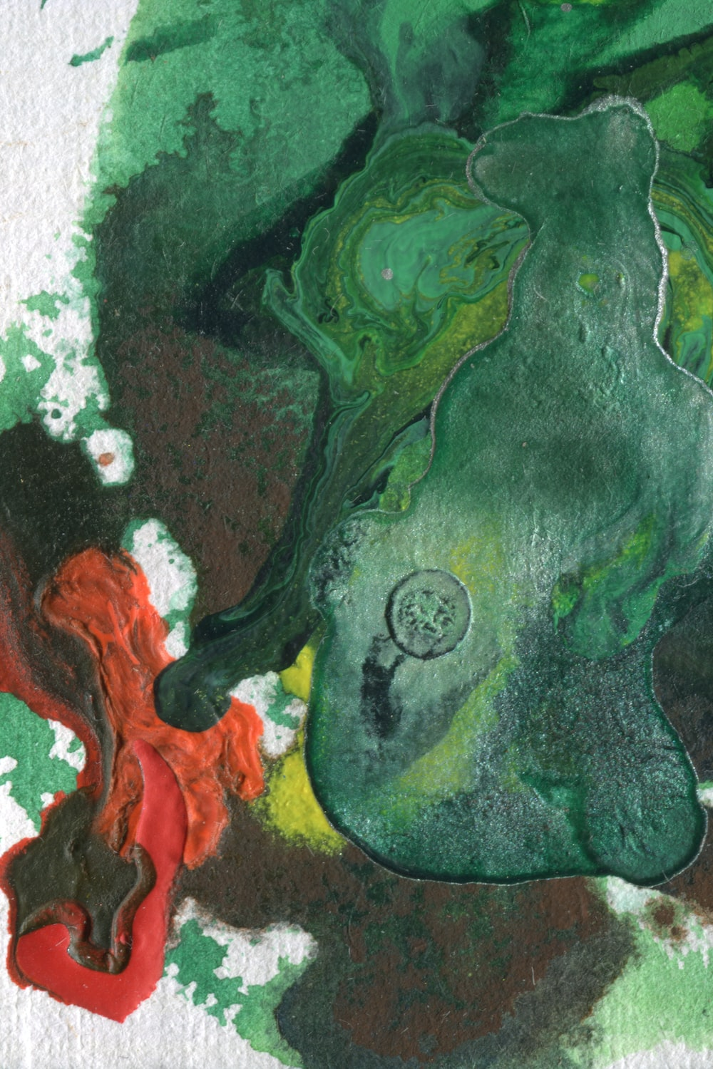 green black and orange abstract painting