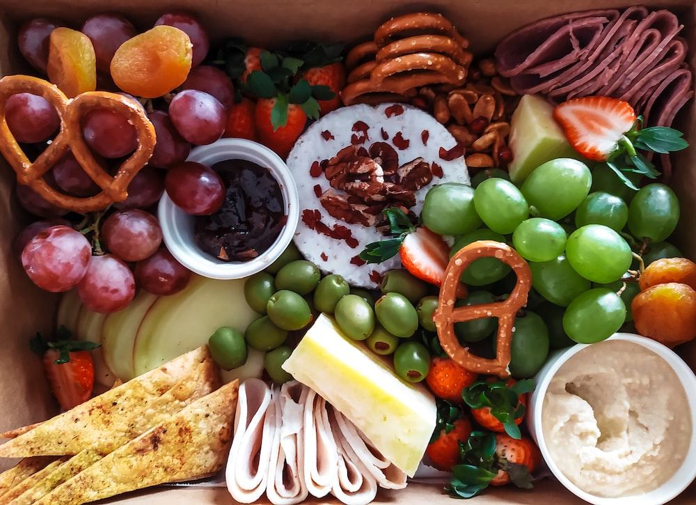 sliced vegetables and fruits on brown wicker basket
