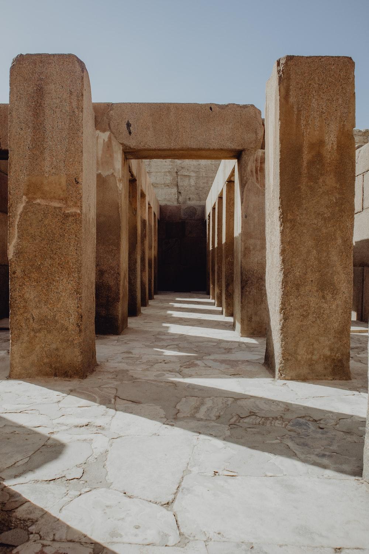brown concrete hallway during daytime