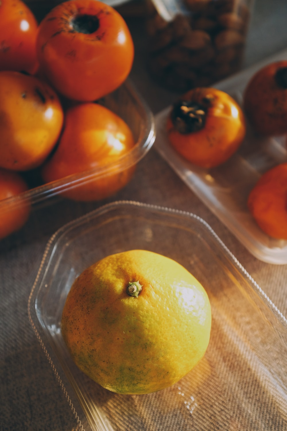 orange fruit on clear glass tray