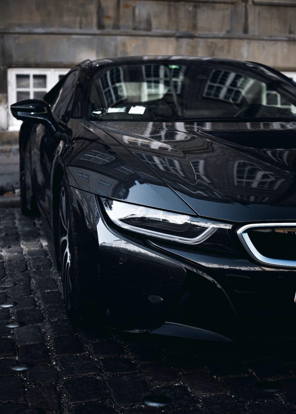 black car parked on gray brick floor