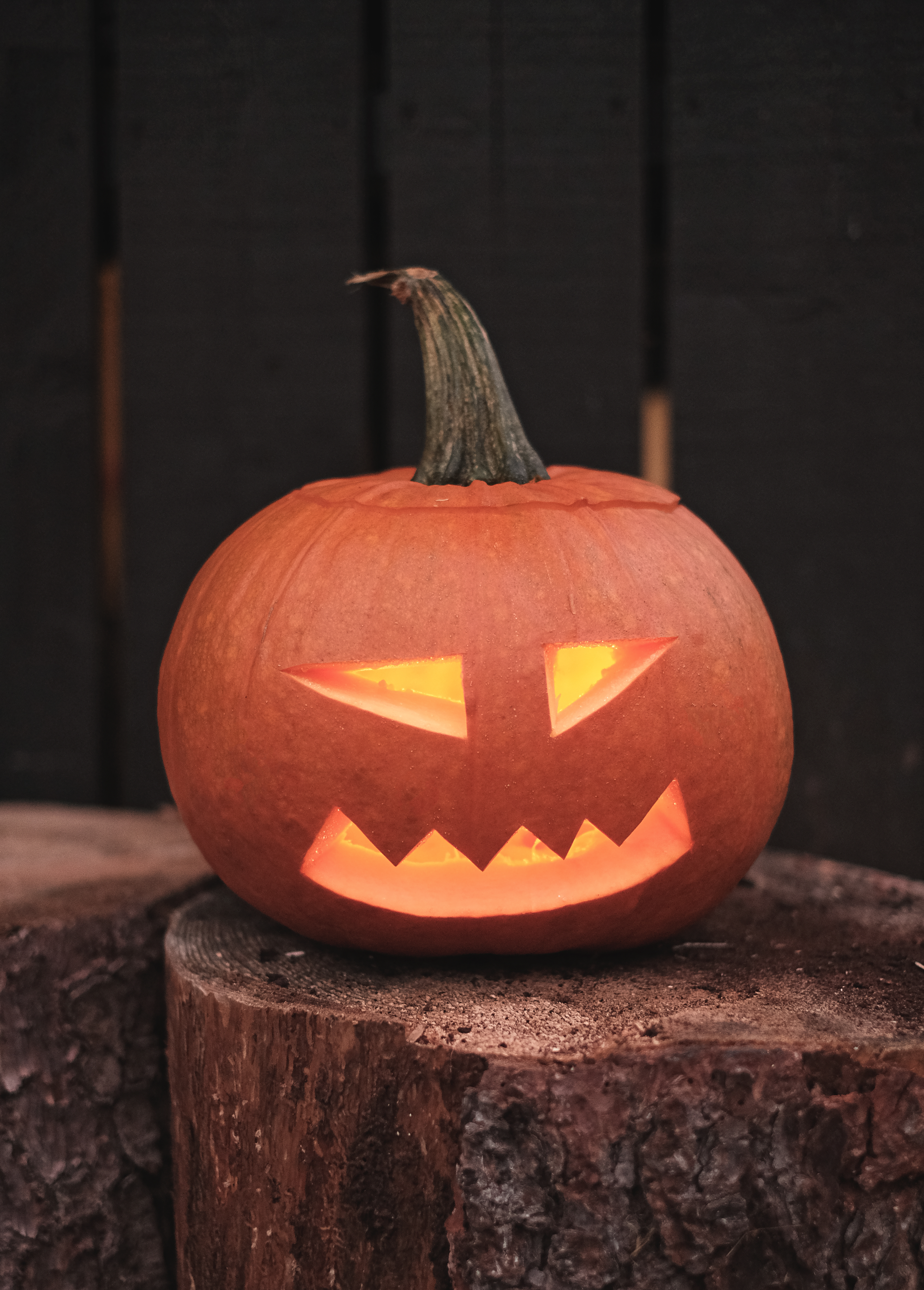 jack o lantern on brown wooden table