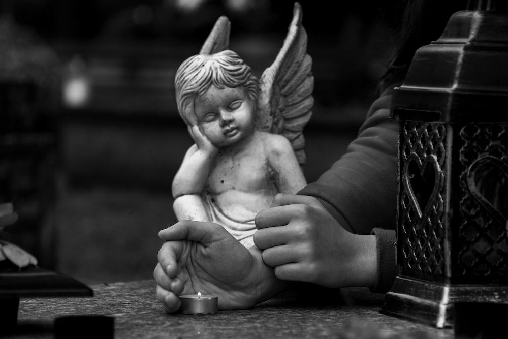 angel ceramic figurine on table