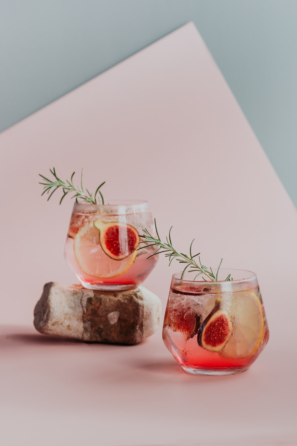 clear drinking glass with red liquid inside