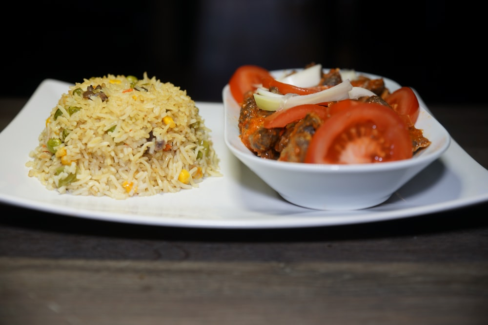 rice with tomato and egg on white ceramic plate