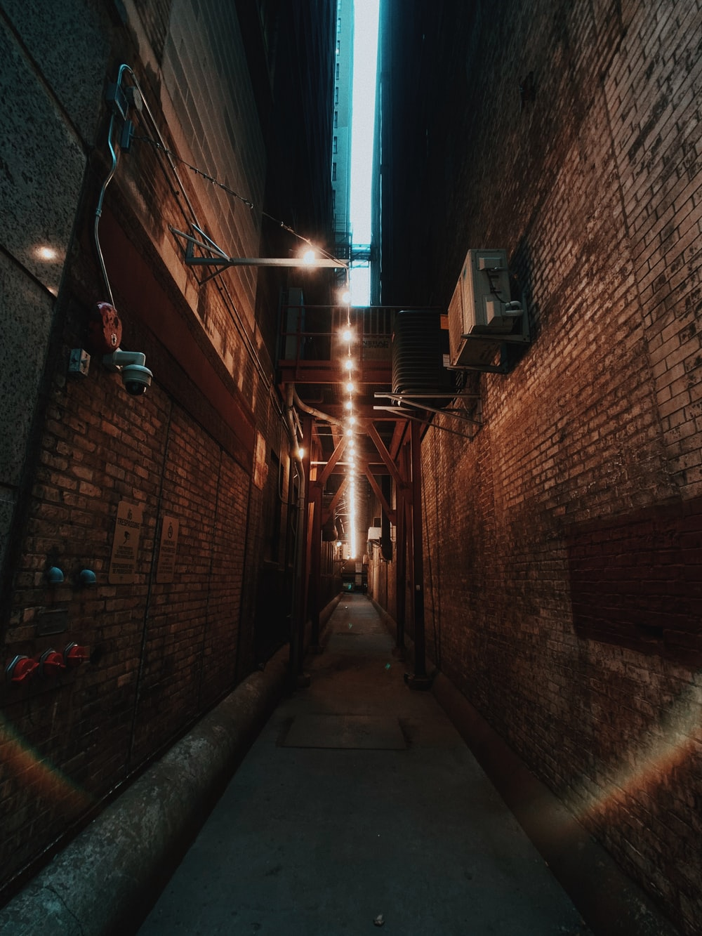 brown brick wall with light fixture