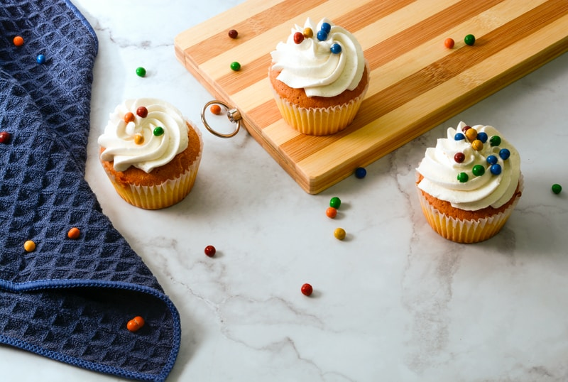 cupcake with white icing on white table