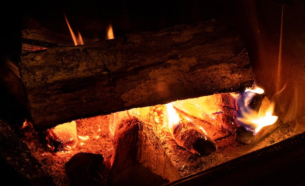 fire in brown wood burner