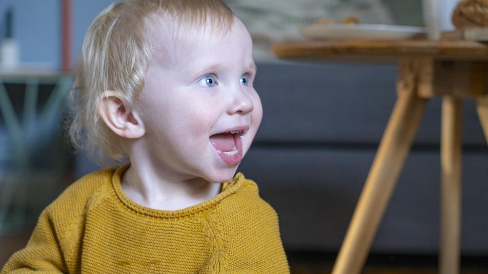 boy in yellow knit sweater