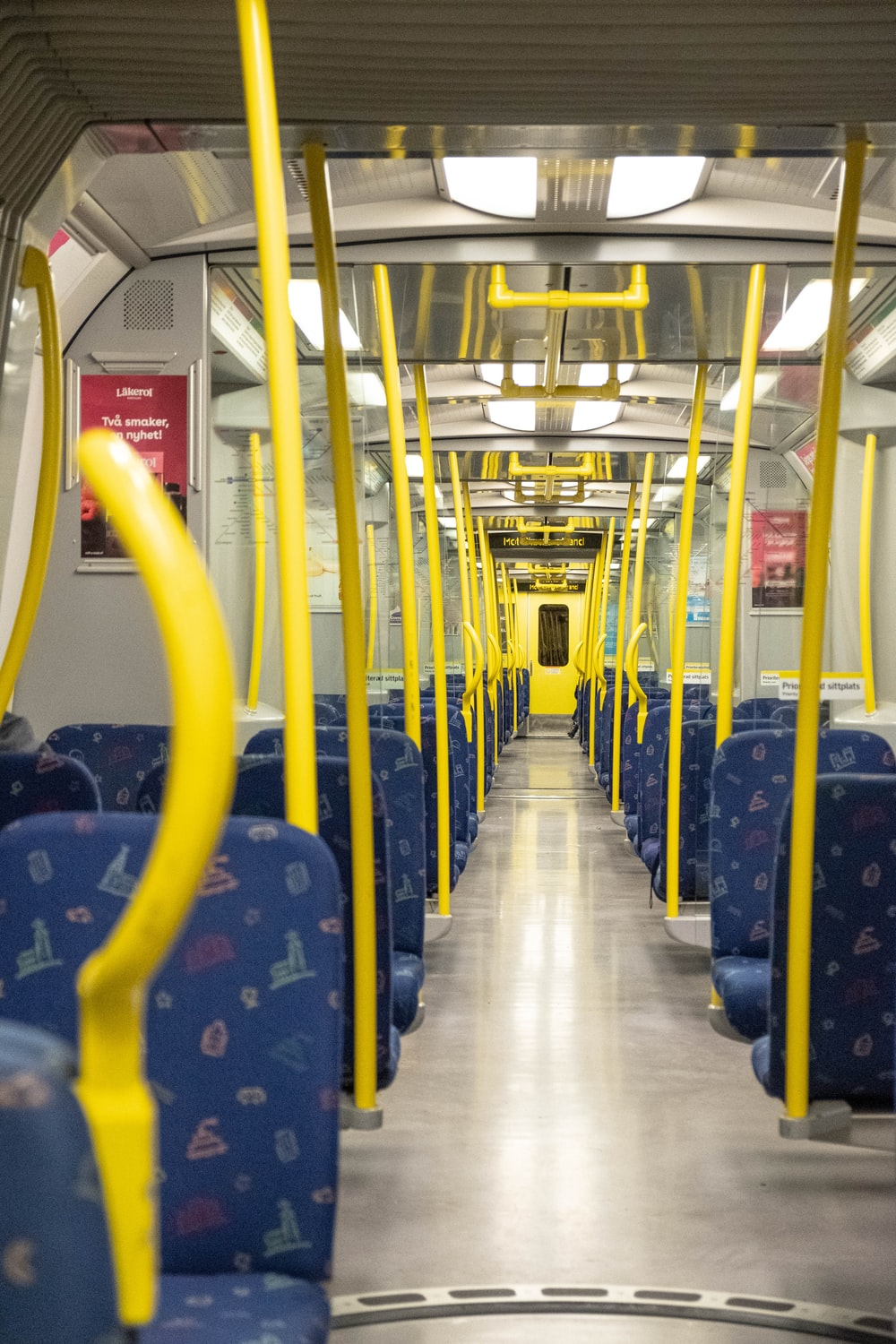 blue and yellow train seats