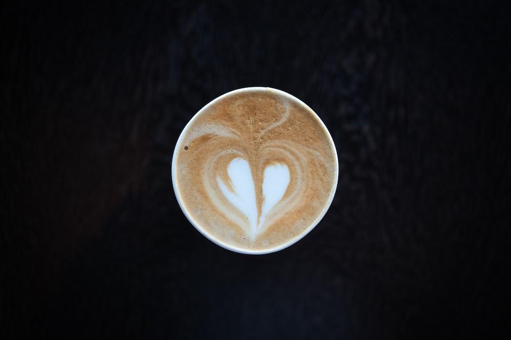 white ceramic mug with heart design