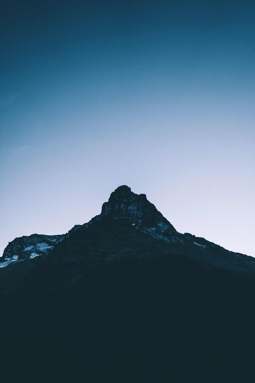black rocky mountain under blue sky during daytime
