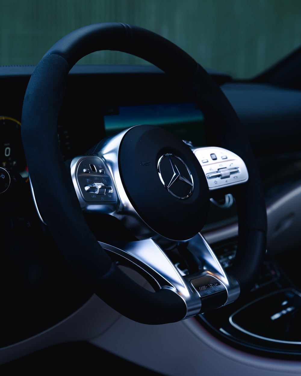 black and silver mercedes benz steering wheel
