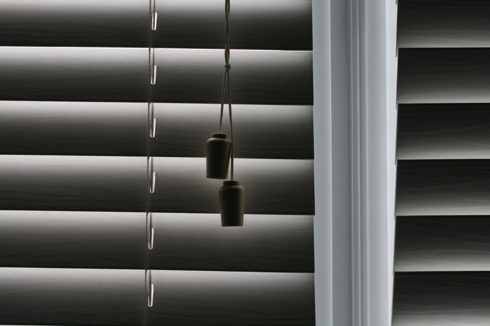 white window blinds with white light bulb