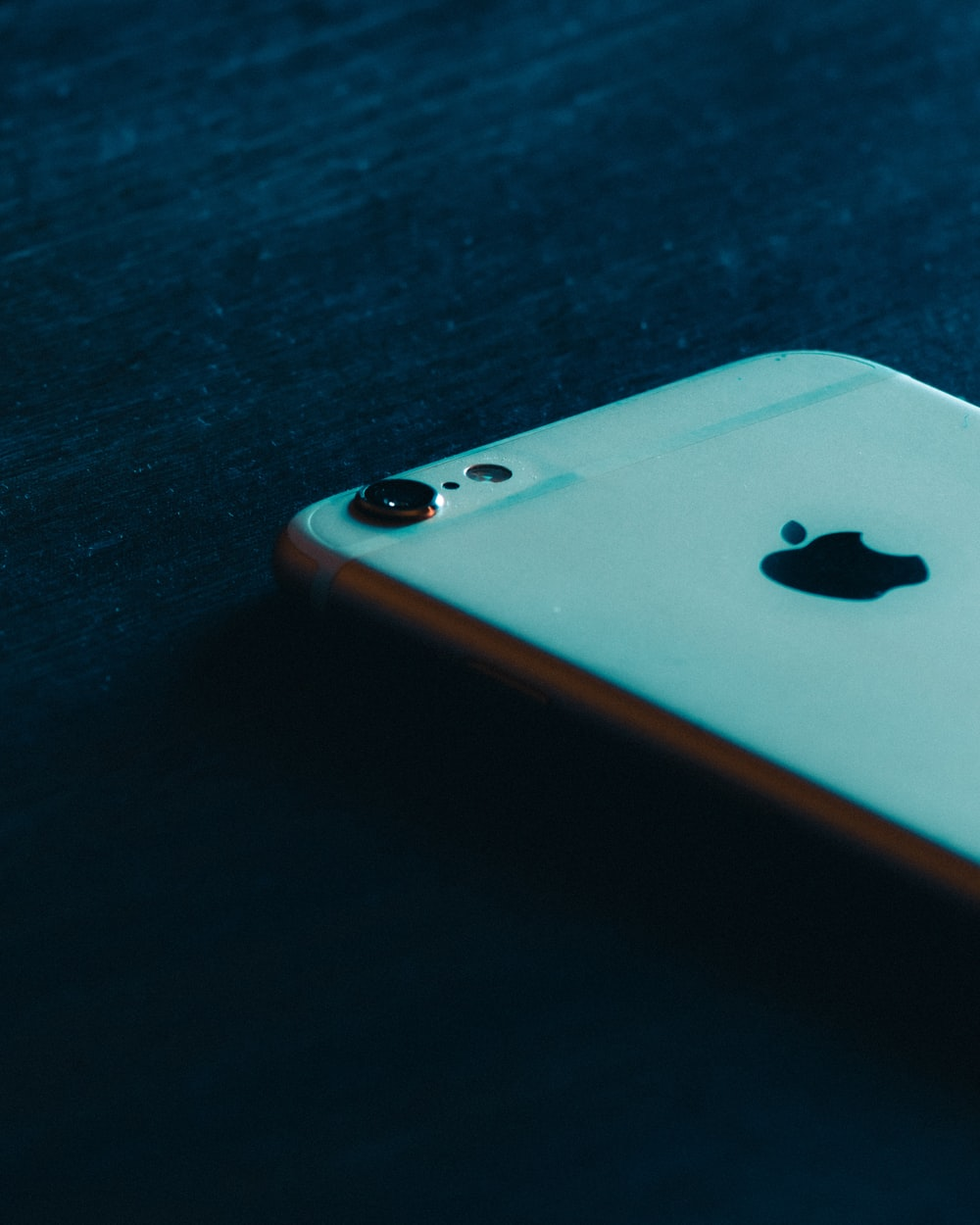 gold iphone 6 on black wooden table