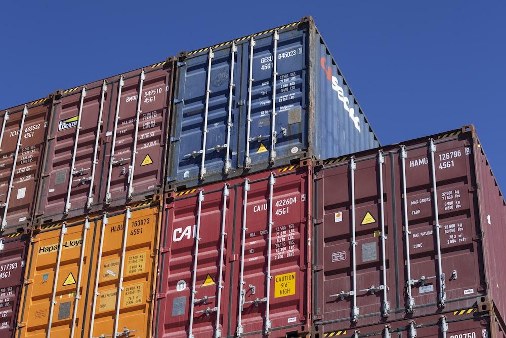 blue and orange intermodal containers