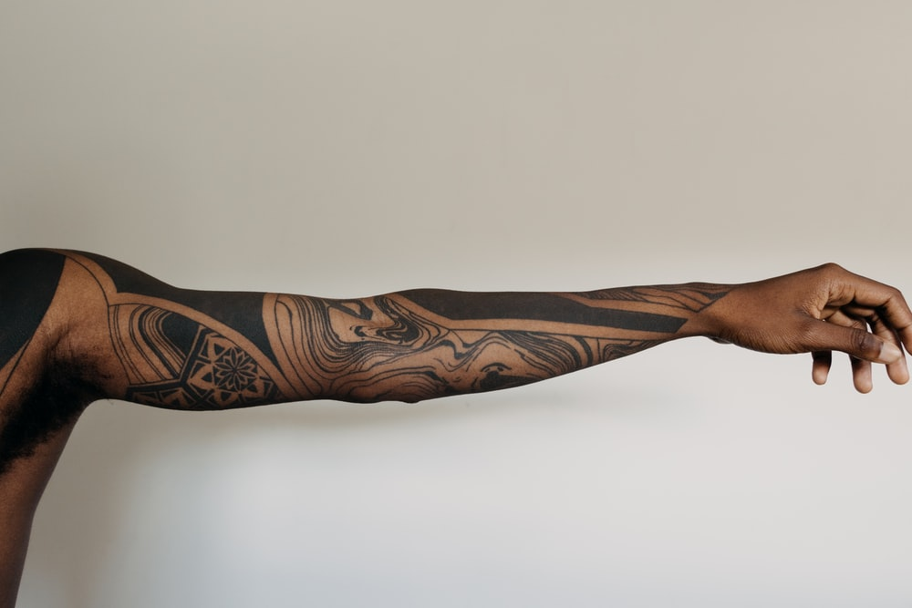 black and brown tribal tattoo