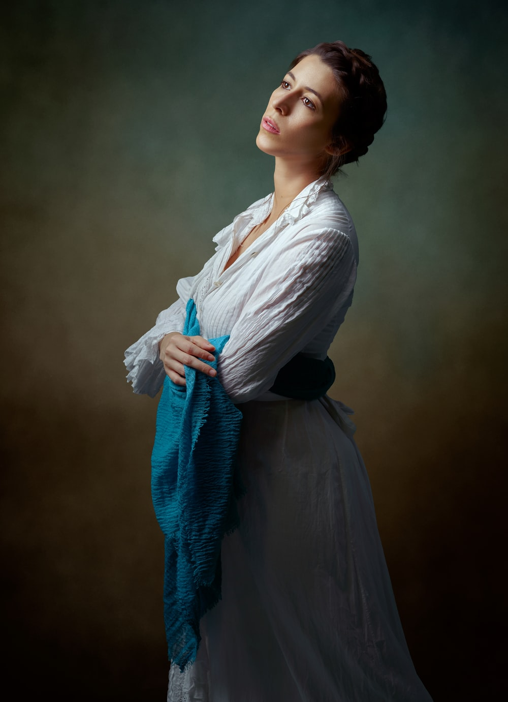 woman in white long sleeve shirt and blue scarf