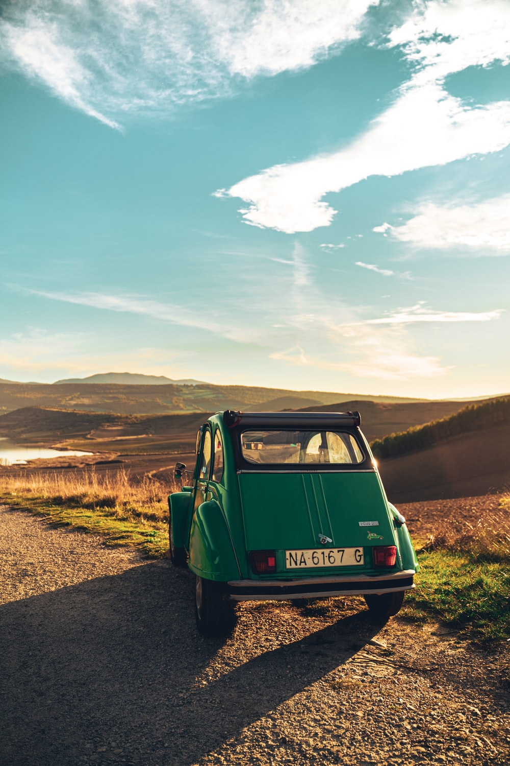 green volkswagen t-1 on dirt road during daytime